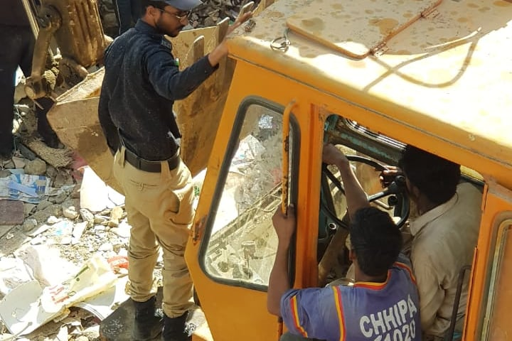 A rescue operation is being carried to recover people buried under the debris. — Photo provided by Imtiaz Ali