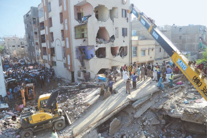 KARACHI: Personnel of rescue and other departments searching for survivors who are trapped under the rubble of a four-storey building at Allahwala Town in the Korangi area on Thursday. At least four people were killed and several others wounded in the incident.—Shakeel Adil / White Star