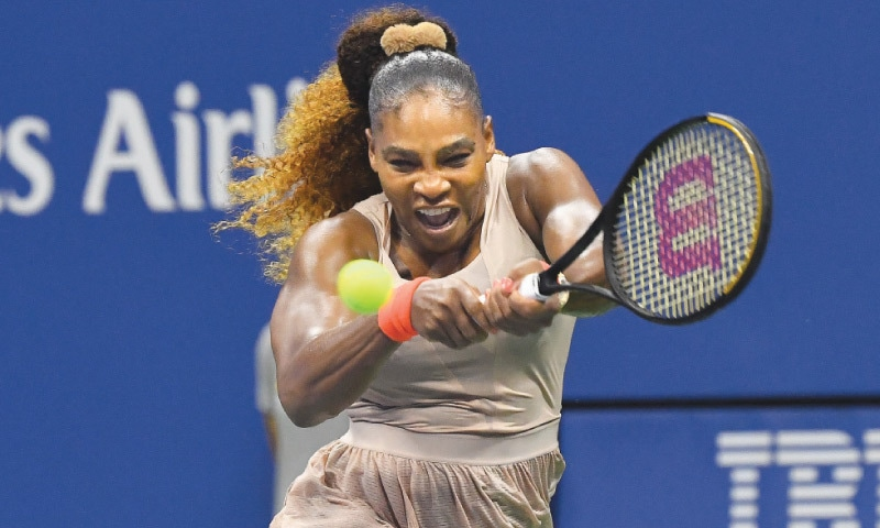 SERENA Williams of the US hits a return to Belarus' Victoria Azarenka during their US Open semi-final at the USTA Billie Jean King National Tennis Center.—Reuters