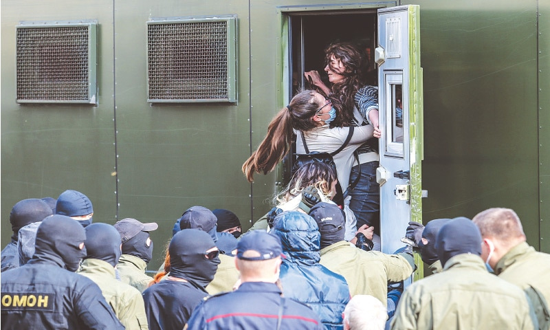 MINSK: Security personnel taking women protesters into custody during a rally against election fraud on Saturday. — AFP
