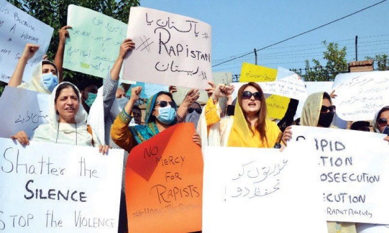 Human right activists stage a protest outside the Peshawar Press Club against the Lahore-Sialkot Motorway gang rape incident demanding an early arrest of the culprits and exemplary punishment for them. — Dawn