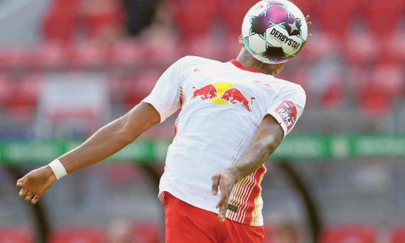 NUREMBERG: RB Leipzig's Christopher Nkunku controls the ball during the German Cup match against Nuremberg at the Max-Morlock-Stadion.—Reuters