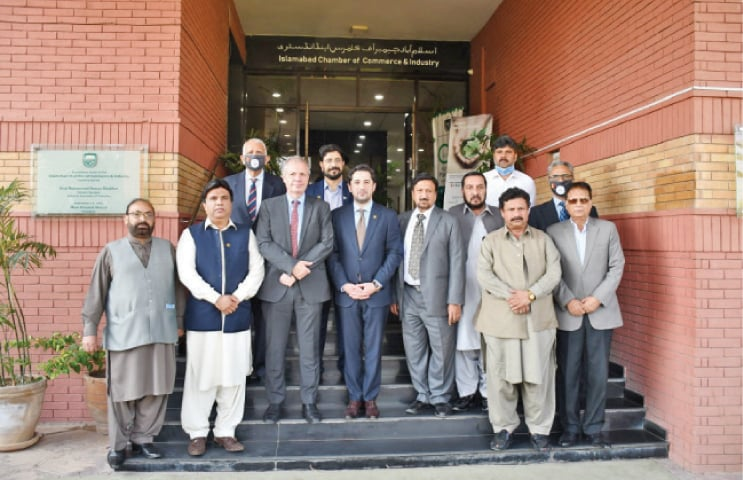Belgian Ambassador Phillipe Bronchain poses with ICCI President Mohammad Ahmed Waheed and other officials on the steps of Islamabad Chamber of Commerce and Industry.