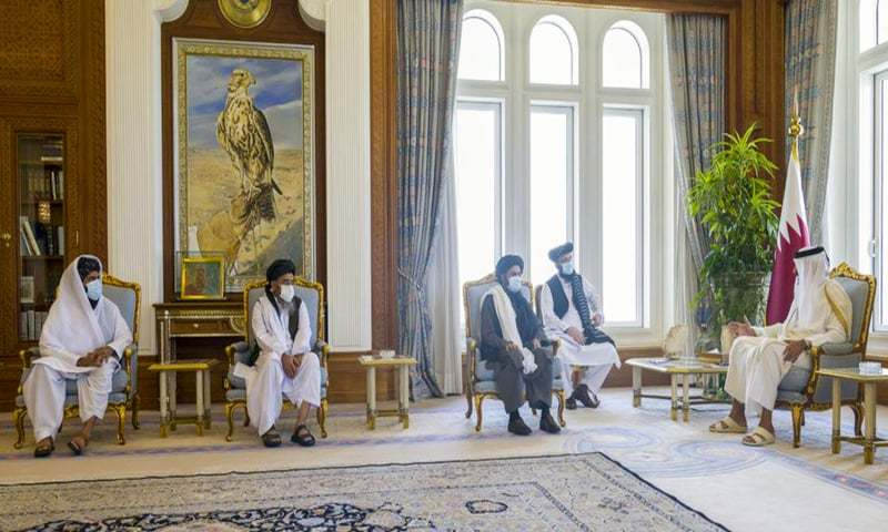A handout picture released by the Qatar News Agency (QNA) on September 13, 2020 shows Qatar's Emir Sheikh Tamim bin Hamad al-Thani (R) meeting with Taliban co-founder Mullah Abdul Ghani Baradar (2nd-R) in the capital Doha. — AFP
