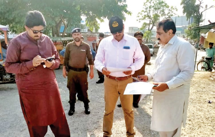 Attock Deputy Commissioner Ali Anan Qammar inspects the site for the food street in Hassanabdal on Monday. — Dawn