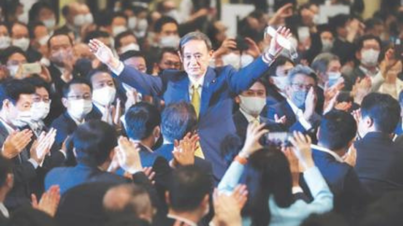 TOKYO: Japan's Chief Cabinet Secretary Yoshihide Suga reacts after he was elected as head of the ruling Liberal Democratic Party on Monday. — AFP
