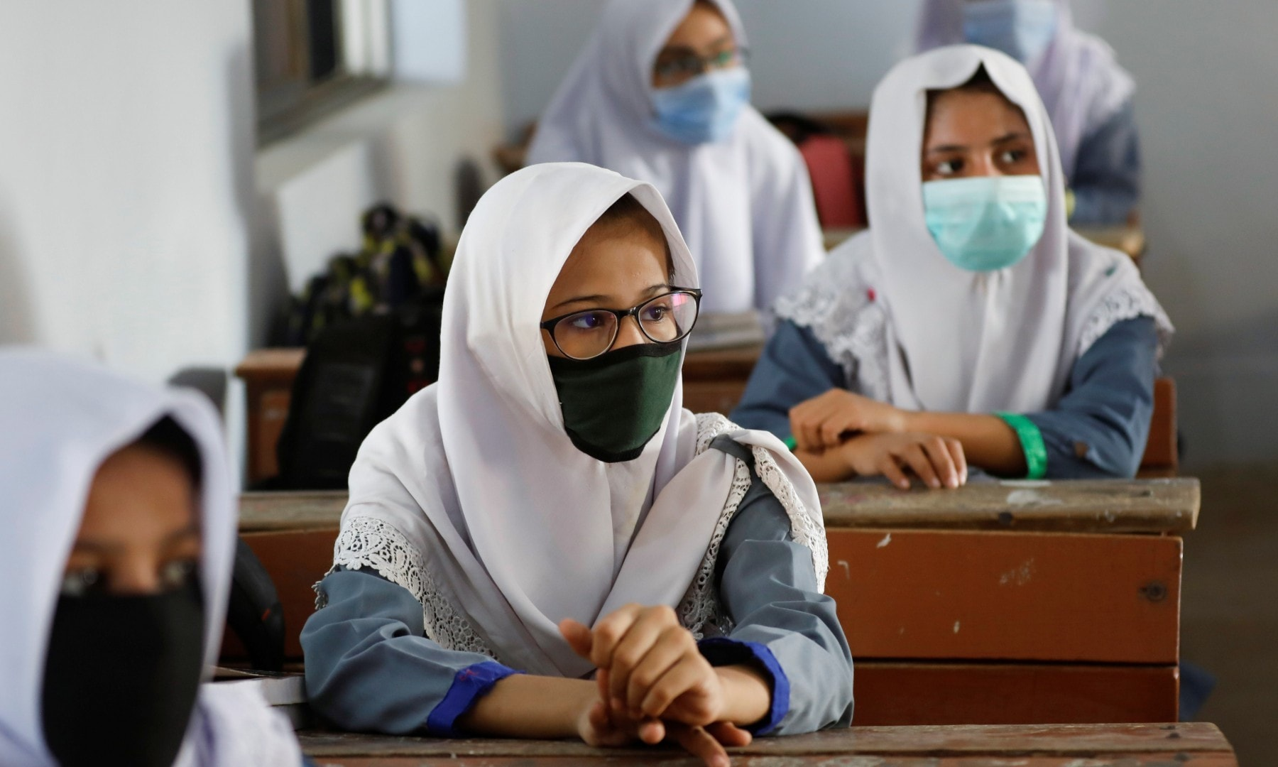 Students keep safe distance while attending a class as schools reopen in Karachi on September 15. — Reuters