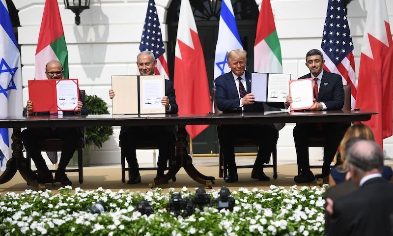 (L-R) Bahrain Foreign Minister Abdullatif al-Zayani, Israeli Prime Minister Benjamin Netanyahu, US President Donald Trump, and UAE Foreign Minister Abdullah bin Zayed Al-Nahyan hold up documents as they participated in the signing of the Abraham Accords where the countries of Bahrain and the United Arab Emirates recognise Israel, at the White House in Washington, DC on September 15. — AFP
