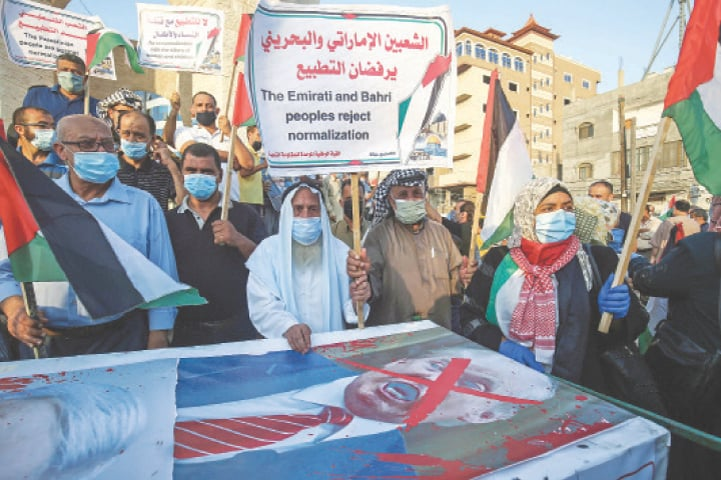 RAFAH: Palestinians protest in Gaza Strip against the United Arab Emirates and Bahrain for signing agreements with Israel.—AFP