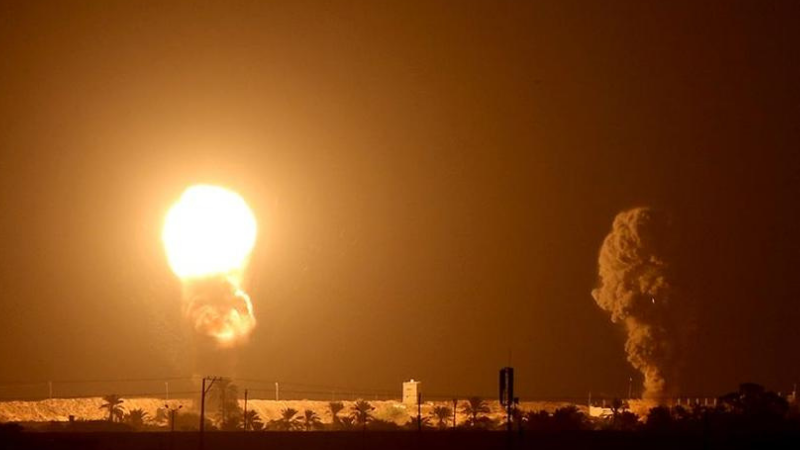 Smoke and flame are seen following an Israeli air strike in the southern Gaza strip. — Reuters