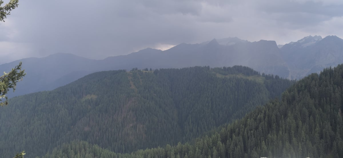 Heavy clouds while descending from Badawi top to Kalam — not a good sign on a dirt trek.