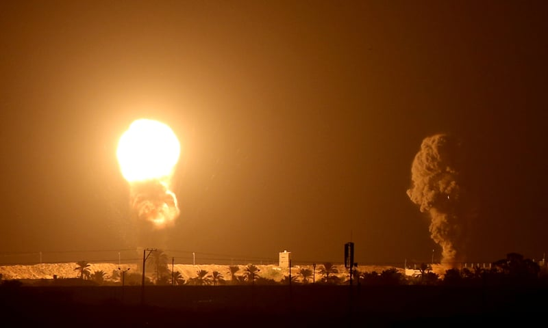 Smoke and flame are seen following an Israeli air strike in the southern Gaza Strip September 16. — Reuters