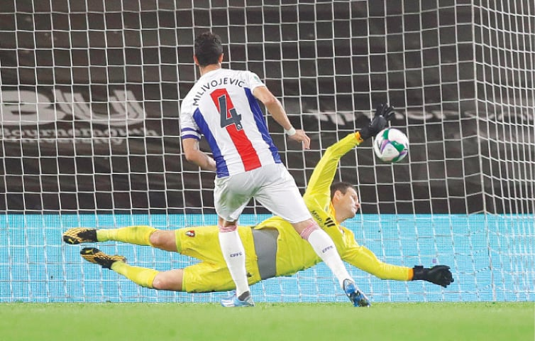 BOURNEMOUTH: Crystal Palace's Luka Milivojevic sees his penalty saved by Bournemouth goalkeeper Asmir Begovic during the shootout in their League Cup match at the Vitality Stadium.—Reuters