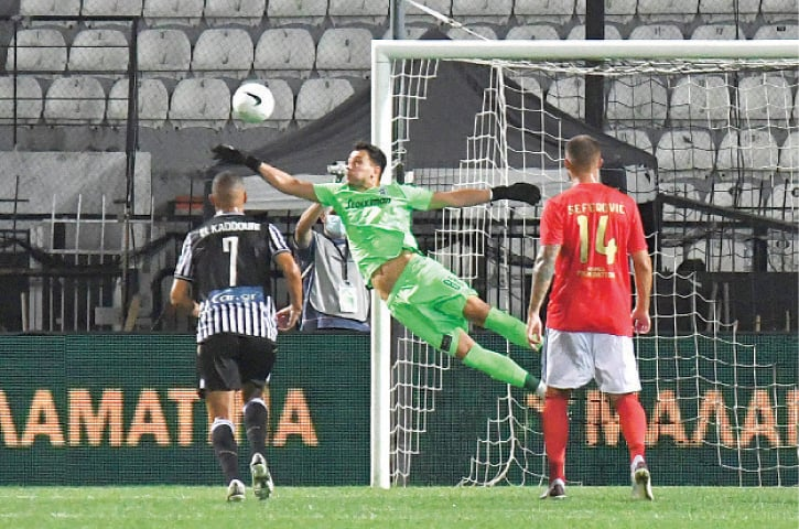 SALONIKA: PAOK goalkeeper Zivko Zivkovic makes a save during the Champions League third qualifying round match against Benfica at the Toumba Stadium.—Reuters