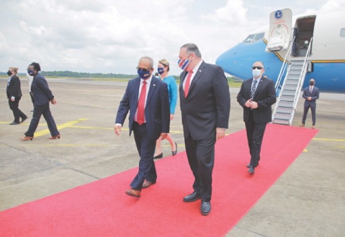 Paramaribo (Suriname): US Secretary of State Mike Pompeo walks with Suriname's Foreign Minister Albert Ramdin upon his arrival in Paramaribo on Thursday.—Reuters