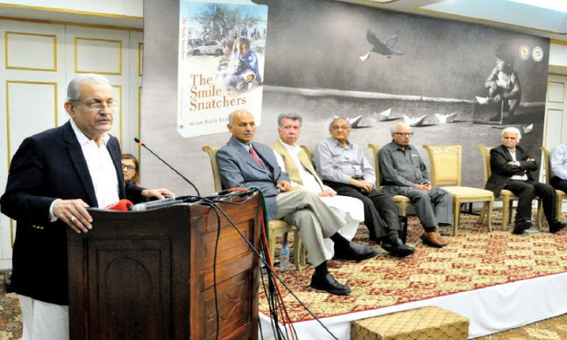 Senator Raza Rabbani speaks at the book launch on Friday. — White Star