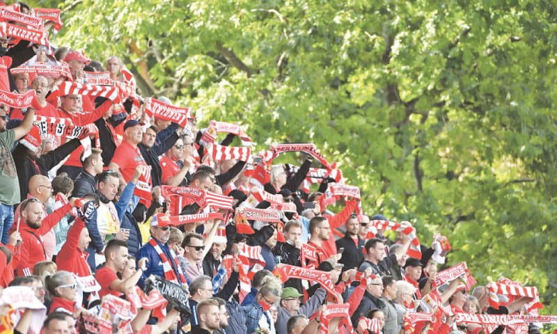 BERLIN: FC Berlin Union's fans react during the Bundesliga match against Augsburg on Saturday. — AFP