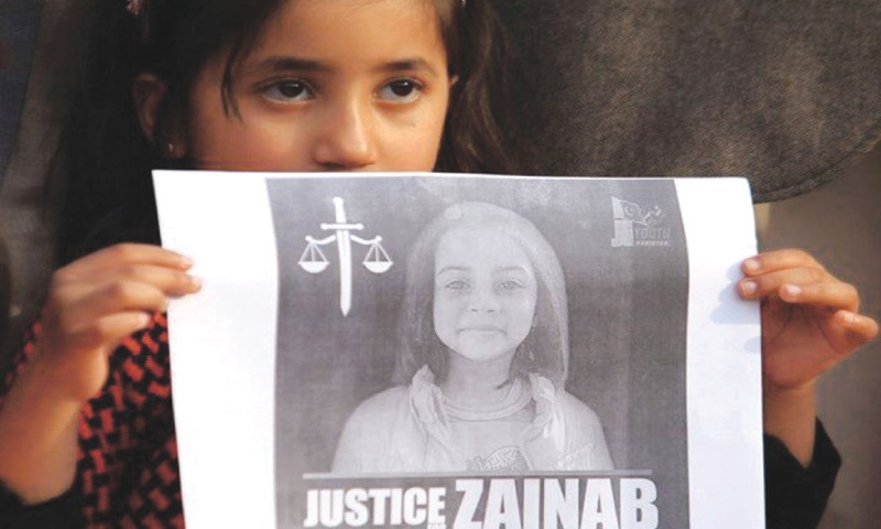 A girl holds up a picture of Zainab Ansari who was raped and murdered in Kasur, during a protest in Islamabad | Reuters