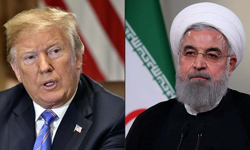 This combination of file pictures created on July 23, 2018 shows US President Donald Trump speaks during a cabinet meeting on July 18, 2018, at the White House in Washington, DC; and a handout picture provided by the Iranian presidency shows President Hassan Rouhani giving a speech on Iranian TV in Tehran. — AFP/File