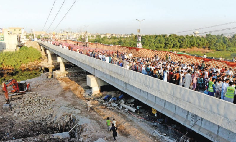 People gather on Burma Bridge after its inauguration on Sunday. — White Star