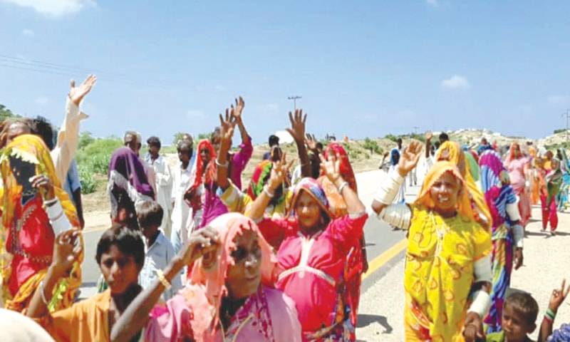 PARTICIPANTS in the march raise slogans as they walk towards Mithi town on Sunday.—Dawn