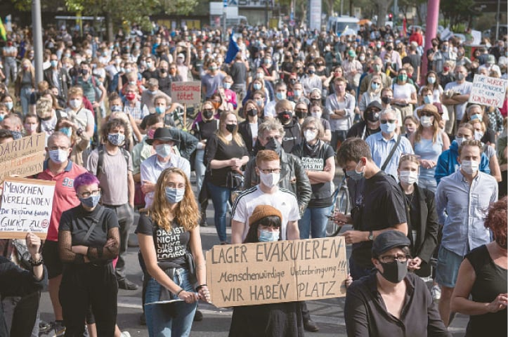 BERLIN: Protesters demonstrate for the evacuation of all migrant centres in Greece after the fire at a refugee camp last week.—AFP