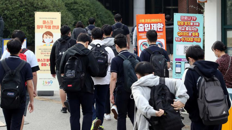 High school students arrive at a high school, amid the coronavirus pandemic, in Seoul, South Korea on Monday. — Reuters