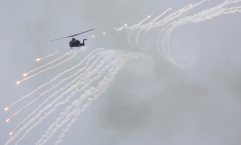 A Taiwanese AH-1 Cobra helicopter fires during the live-fire, anti-landing Han Kuang military exercise, which simulates an enemy invasion, in Taichung, Taiwan on July 16. — Reuters