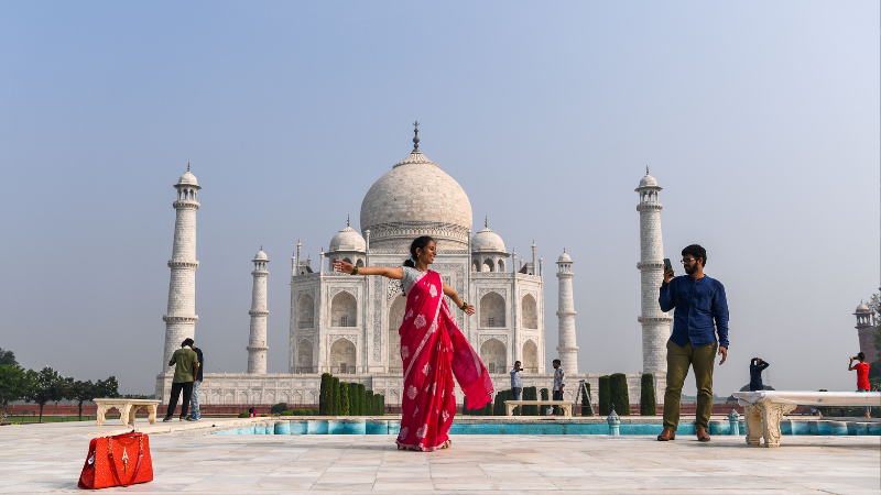 Tourists visit the Taj Mahal in Agra on Sept 21. The Taj Mahal reopened to visitors in a symbolic business-as-usual gesture even as India looks set to overtake the US as the global leader in coronavirus infections. — AFP