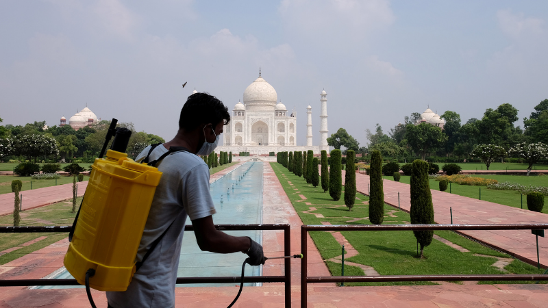 A man sanitises railings in the premises of Taj Mahal after authorities reopened the monument to visitors, amidst the coronavirus. — Reuters