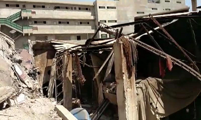 A view of the collapsed building. — DawnNewsTV