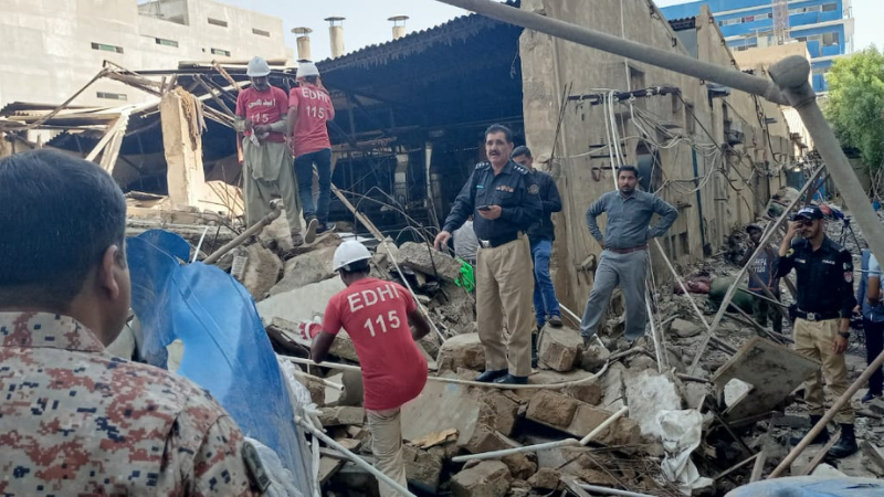 Police and rescue officials at the site of the collapsed building. — Photo courtesy: Edhi Foundation