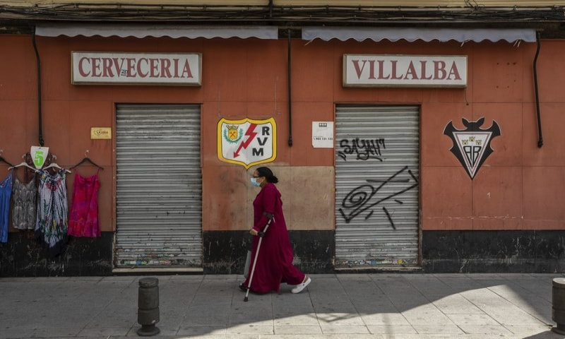 A woman wearing a face mask to prevent the spread of coronavirus walks in the southern neighbourhood of Vallecas in Madrid, Spain on Monday, September 21. — AP
