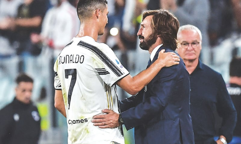 TURIN: Juventus coach Andrea Pirlo congratulates Cristiano Ronaldo at the end of the Serie A match against Sampdoria at the Juventus Stadium in Turin.—AFP