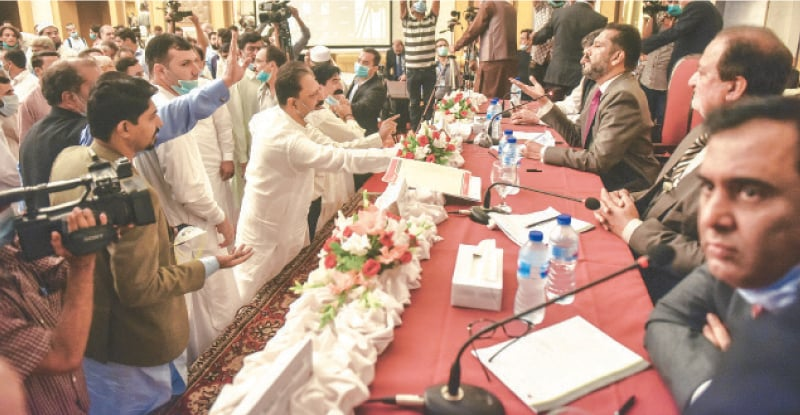 KARACHI: People trying to convince officials to continue proceedings during the suspension of the Nepra hearing about K-Electric affairs on Monday. — Fahim Siddiqi / White Star