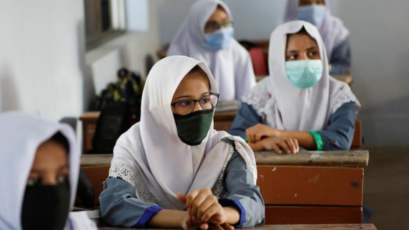 Students keep safe distance while attending a class as schools reopen amid the coronavirus outbreak in Karachi, Pakistan.