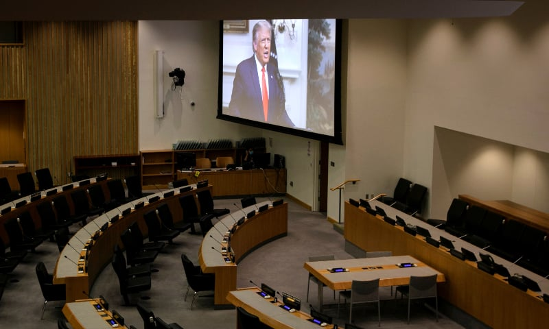 US President Donald Trump is seen on a screen through a window to an empty conference room as he delivers a pre-recorded address to the 75th annual UN General Assembly at United Nations headquarters in New York, US, September 22. — Reuters