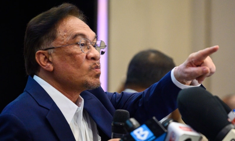 Malaysian opposition leader Anwar Ibrahim points during a press conference at a hotel in Kuala Lumpur on September 23. — AFP