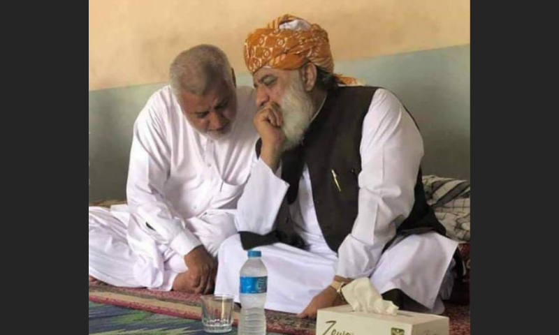Musa Khan (L) is seen talking to JUI-F chief Maulana Fazlur Rehman, of whom he is a close aide. — Photo provided by Sirajuddin