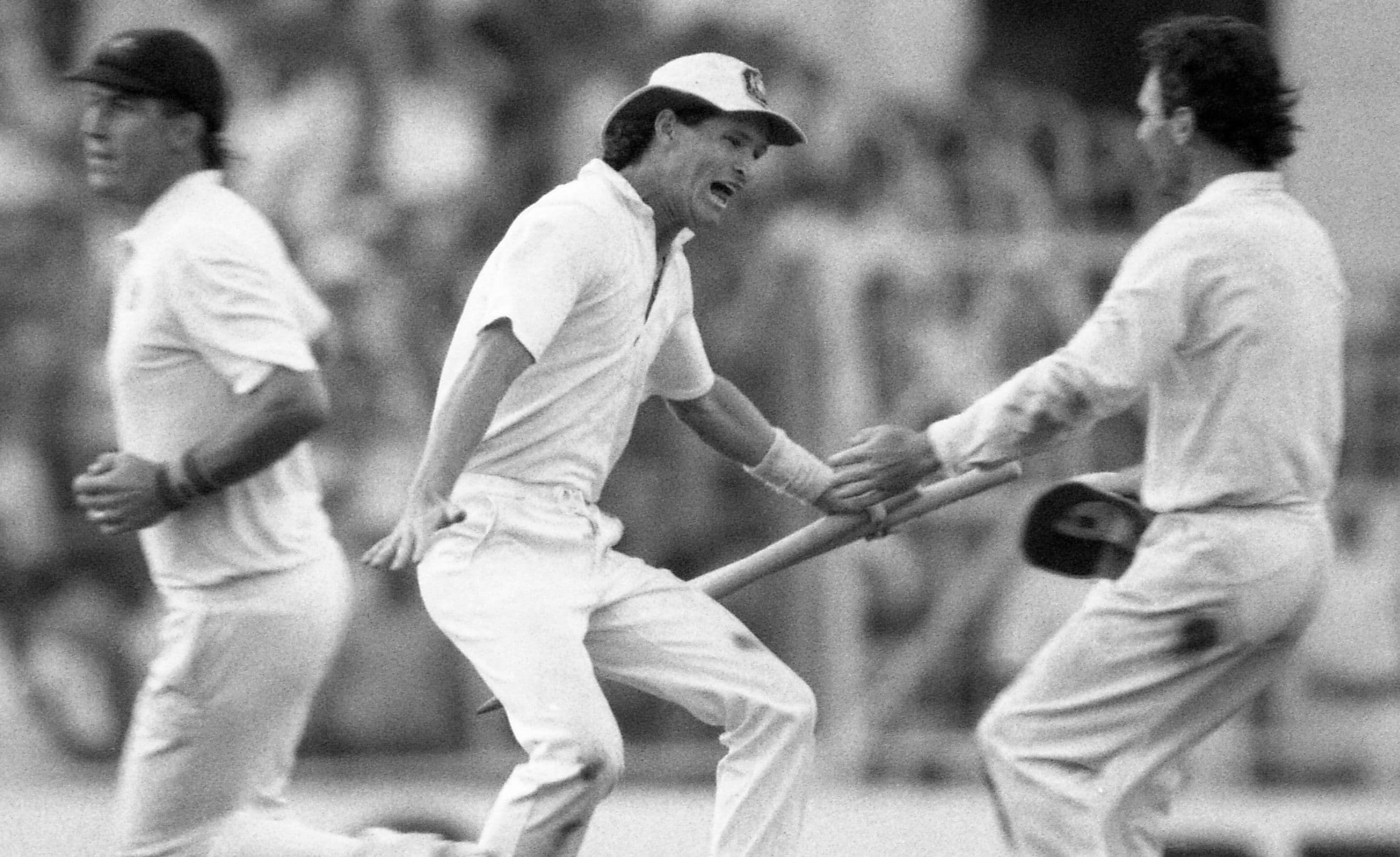 In this Nov 8, 1987 file photo, Australian batsman Dean Jones holds the stumps as he races to embrace team captain Allan Border, right, in a moment of jubilation, in Calcutta, India. — AP