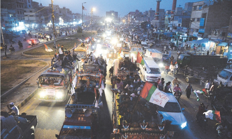 AN MQM caravan passes through Liaquatabad on Thursday evening on its way to the Quaid's mazar. —Shakil Adil/White Star