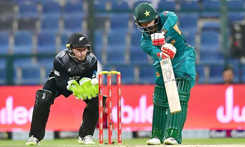 Pakistan cricketer Mohammed Hafeez (R) is watched by New Zealand's wicketkeeper Tim Seifert as he plays a shot during the first T20 cricket match between Pakistan and New Zealand at The Abu Dhabi Cricket Stadium in Abu Dhabi on October 31, 2018. — AFP/File