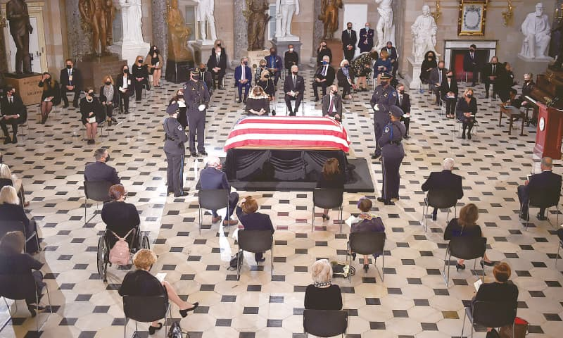 WASHINGTON: Members of Congress and guests pay their respects to the late justice Ruth Bader Ginsburg as her casket lies in state during a memorial service in the  US Capitol on Friday.—Reuters