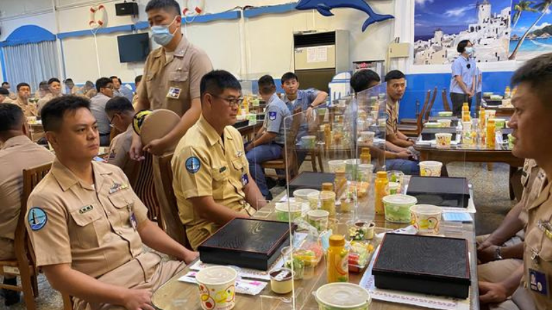Taiwan navy sailors sit with partitions on the dining tables, part of coronavirus pandemic prevention measures, before Taiwan's President Tsai Ing-wen arrives for lunch with them, at the Zuoying naval base in Kaohsiung, Taiwan on Sept 26. — Reuters