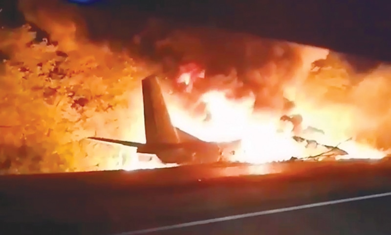 A Ukrainian AN-26 military plane bursts into flames after it crashed in the town of Chuguyiv on Friday. — AP