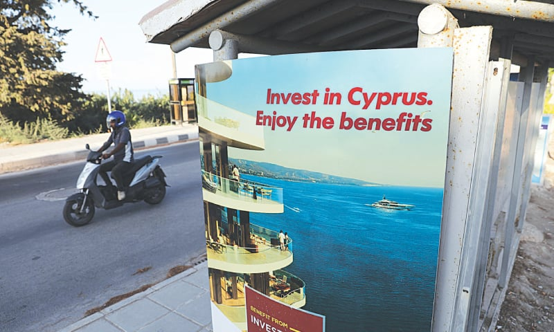 A billboard lures investors to Cyprus.—Reuters