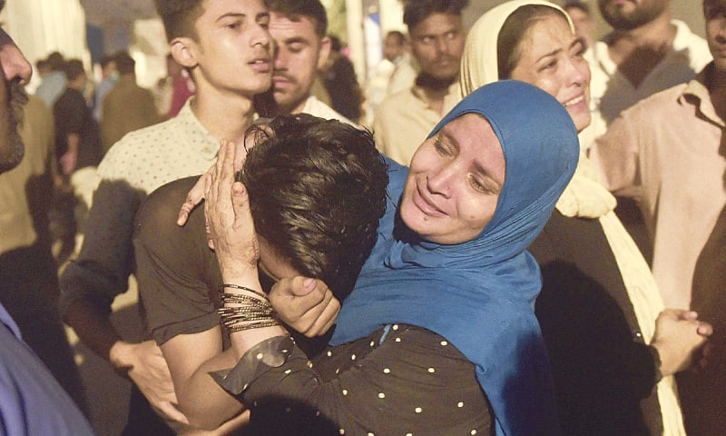 Karachi: People mourn the death of their relatives in a passenger van accident, outside a hospital on Sunday. — AFP