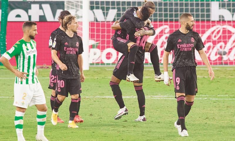 SEVILLE: Real Madrid's Sergio Ramos celebrates with team-mate Casemiro at the Benito Villamarin Stadium.—AFP
