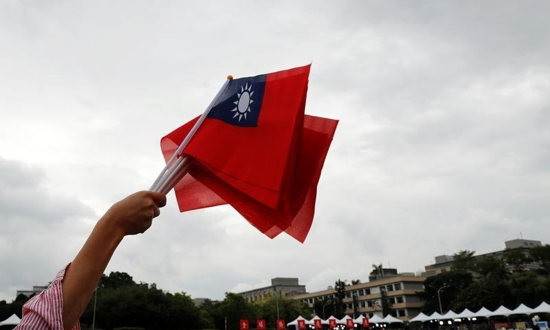 In this file photo, an audience waves Taiwanese flags during the National Day celebrations in Taipei on October 10, 2018. — Reuters
