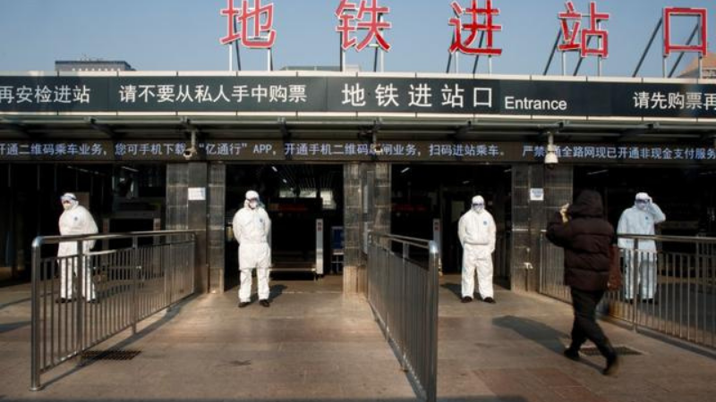 In this Jan 2020 file photo, workers take the body temperature of passengers before they enter the subway station outside the Beijing Railway Station. — Reuters